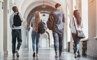 Students walk down school hallway